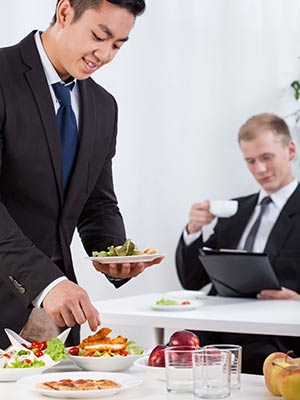 business people eating at work - corporate events